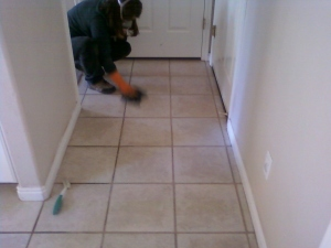 cleaning the grout with toilet boil cleaner and a scrub brush. Keep the windows open and have a mask to breath though.