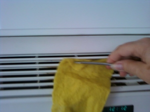 cleaning with the scrubber and a screw driver to clean the dirt out of the micro wave