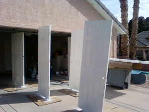 the parade of doors so that both sides could be painted at one time- out in the sun to dry